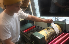 Adam working on the letterpress
