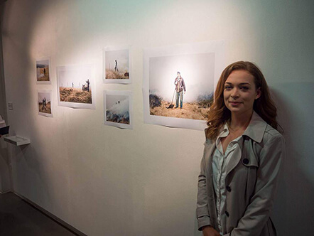 Nicola Woods in front of some of her photographs